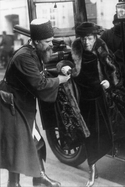 One of the last photos of DE Marie Feodorovna, 1924 : The photo was taken close to the Russian Orthodox Church of Alexander Nevsky in Copenhagen, Denmark. Assisting her is Cossack Timophey Yaschik. Yaschik was the Dowager Empress's bodyguard and stayed with her from 1912 until her death in 1928.