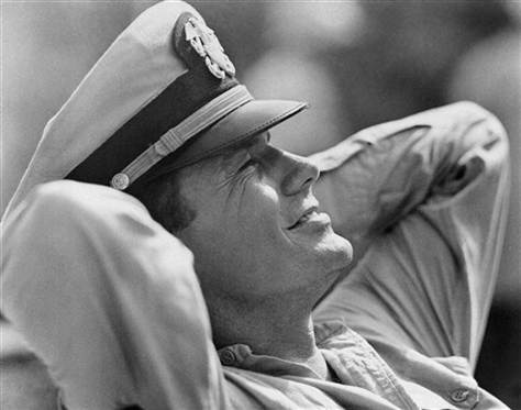 """In this Feb. 25, 1963 file photo, actor Cliff Robertson takes a break as the skipper of the PT 109, Lt. John F. Kennedy, in the movie """"PT 109."""""""