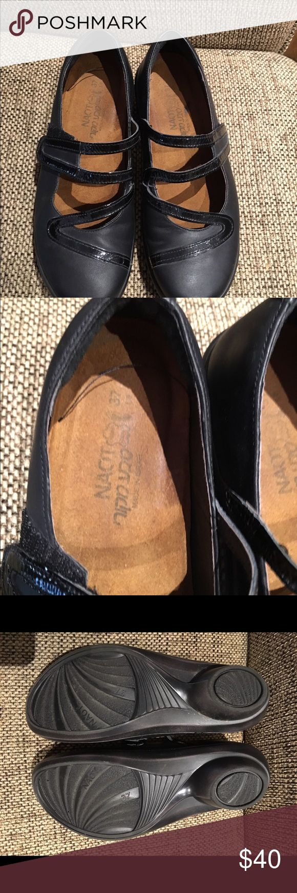Naot shoes Black and the swirled design is like patten leather. They are like brand new! Naot Shoes Flats & Loafers