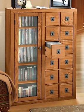 CD drawers and DVD shelves all in one cabinet - what a brilliant idea to keep your room tidy