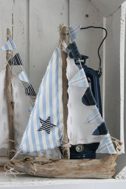 DIY sailboat using driftwood... Cute!