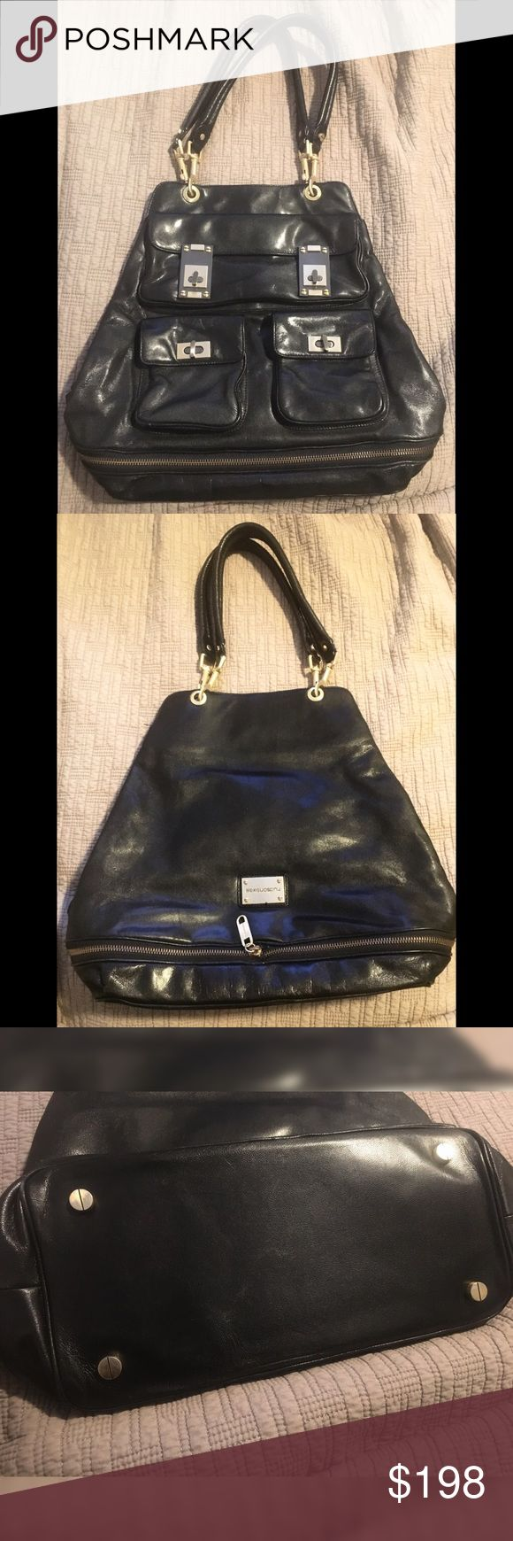 """Authentic Alexis Hudson Aspen Black Leather Bag This bag has been gently used a handful of times, with little to no sign of wear. The interior is clean. The leather is smooth and has bottom extension with zipper opening to access it. Inside large zipper pocket, 2 additional pickets and 3 outter pockets. Approx. 12"""" L. 14"""" H (not extended). Alexis Hudson Bags"""