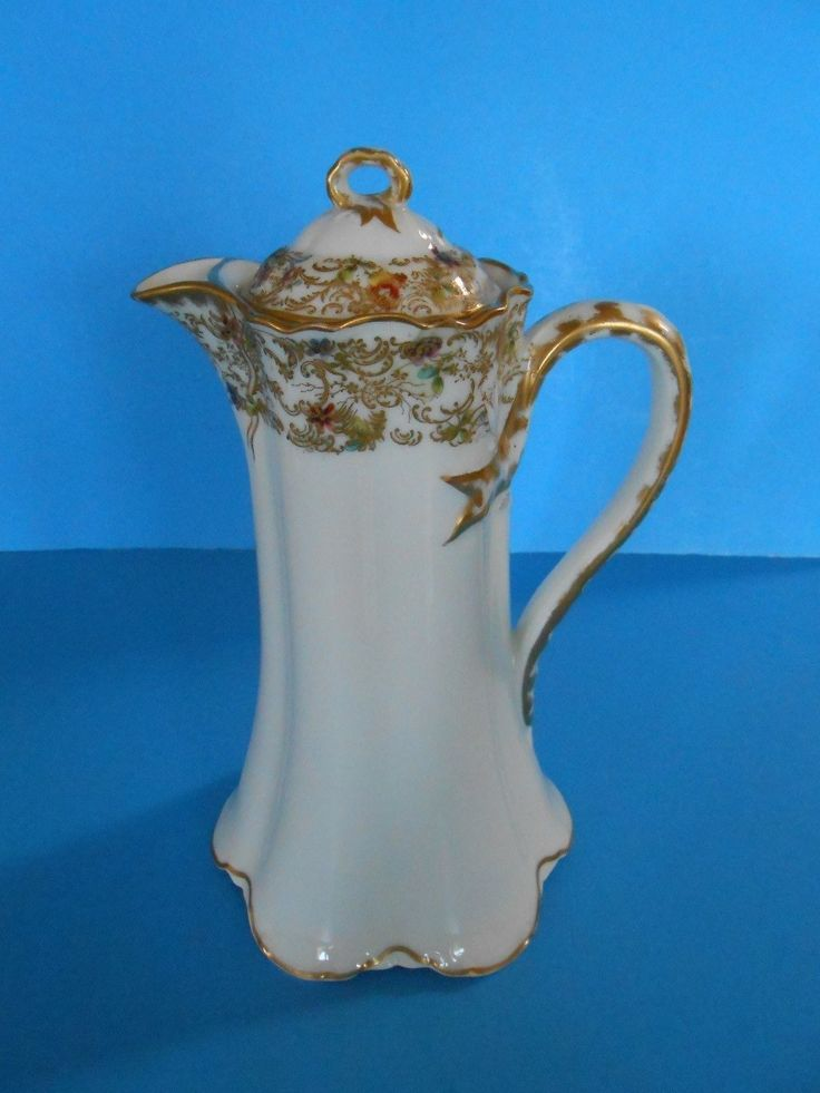 Up for sale is a lovely antique porcelain hot chocolate pot made by Haviland & Co. of Limoges, France for Burley & Co. of Chicago. It is hand painted with delicate flowers at the rim in a band of scrolling gold and the lid repeats the pattern. | eBay!