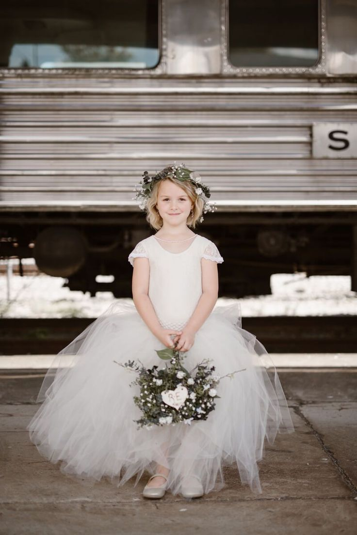 Flower girl with greenery basket - Neutral Colored Vintage Wedding | Erin Morrison Photography - KnotsVilla