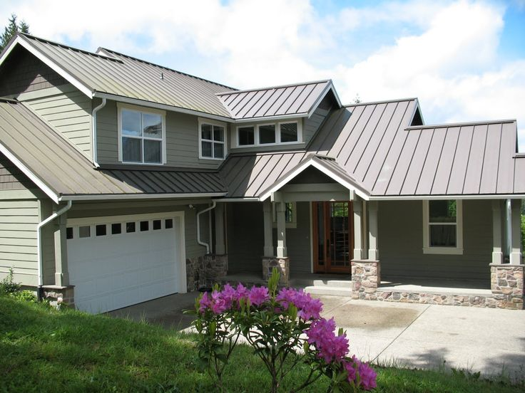 Grey metal roof with green painted house.  Looks nice together.