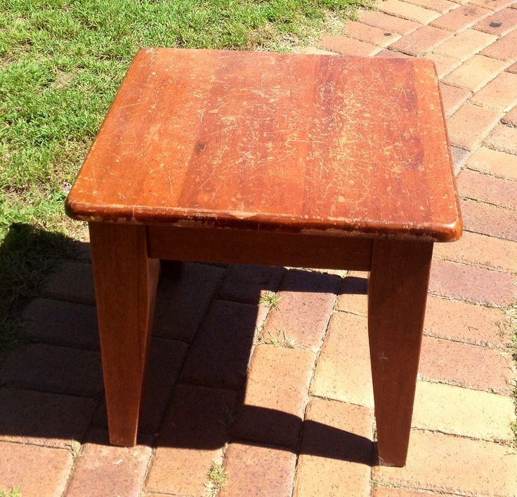 Coffee table with many years of wear & tear.