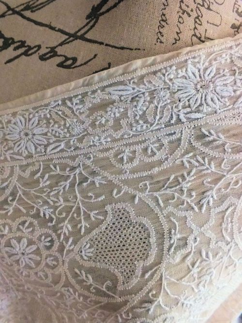 This graceful silk gauze shawl is fully hand-embroidered. It features a thin chikankari border running on the four edges of the shawl and a continuous chikankari design all-over. The centre of some flowers have been embellished with Mukaish - a metal thread embroidery.
