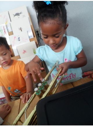 Sometimes just holding with a musical instrument opens a child's mind to music and sound! (#blog attached) #reggio