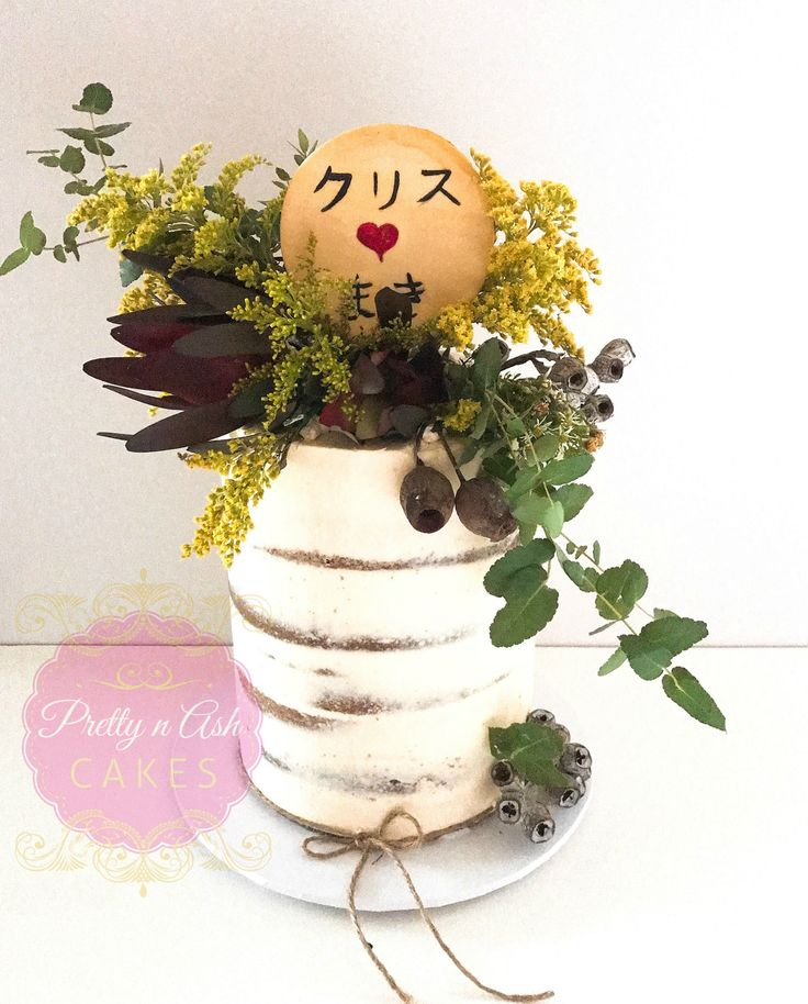 Semi naked cake with Australian native blooms