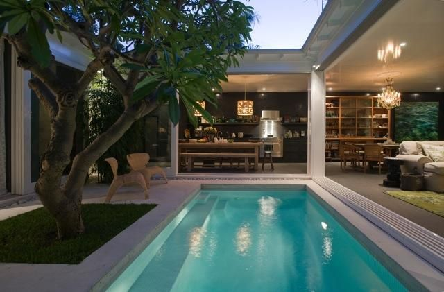 My dream house is very small and wrapped around a lap pool