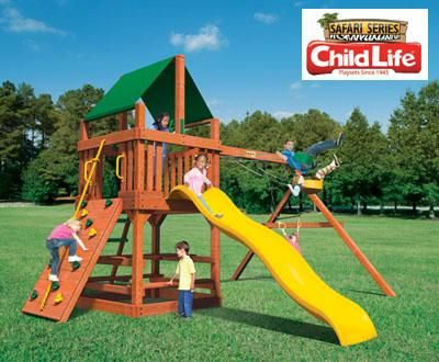 Tiger Tower - Let your inner Tiger Roar in this Jungle Series Playset!  rock wall with rope • slippery slide • high-swinging swings • high-flying trapeze • picnic table • ship's wheel • telescope • Larger, 22 Sq. ft. Deck • Taller, 52'' Deck Height • Taller, 81'' Swing Beam • 10' 3'' Total Height • 16' 9'' Wide X 16' 6''Deep