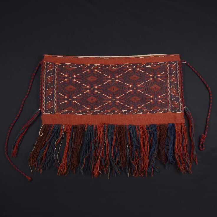 Bag used for food storage, hanging within the tents, or for food transportation. Only the exposed side is finely woven with the traditional motifs of Anatolian kilims. Size: 89 x 45 cm.
