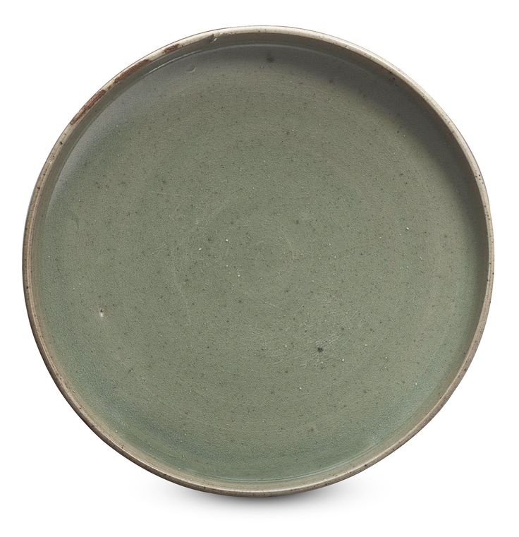 PROPERTY OF A GENTLEMANA GREEN JUNYAO SHALLOW DISHSONG-JIN DYNASTY (AD 960-1234)The dish has shallow, widely flared body rounding upwards at the rim, and is covered with a glaze of mottled grey-green color.5½ in. (14 cm.) diam.Provenance:Blitz Chinese Ceramics & Works of Art, Netherlands, 2006.Please note this lot is the property of a private collector.