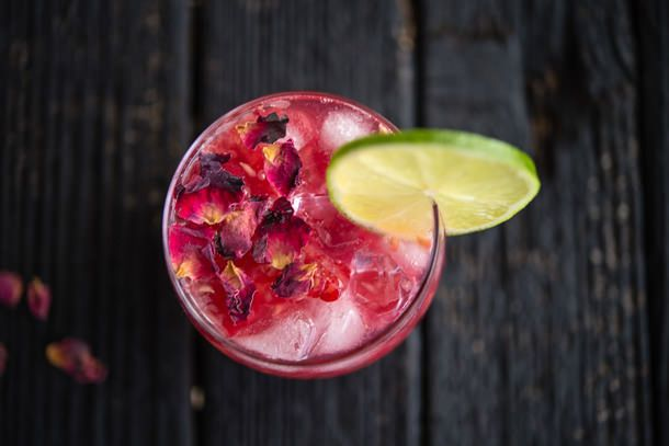 Raspberry Rose Gin and Tonic Recipe. Key Cocktail Ingredients: Gin, Rosewater, Lime, Rasberries