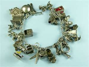 This is an incredible charm bracelet loaded with 24 sterling vintage jewelry charms. From the late 1940s to early 1950s.