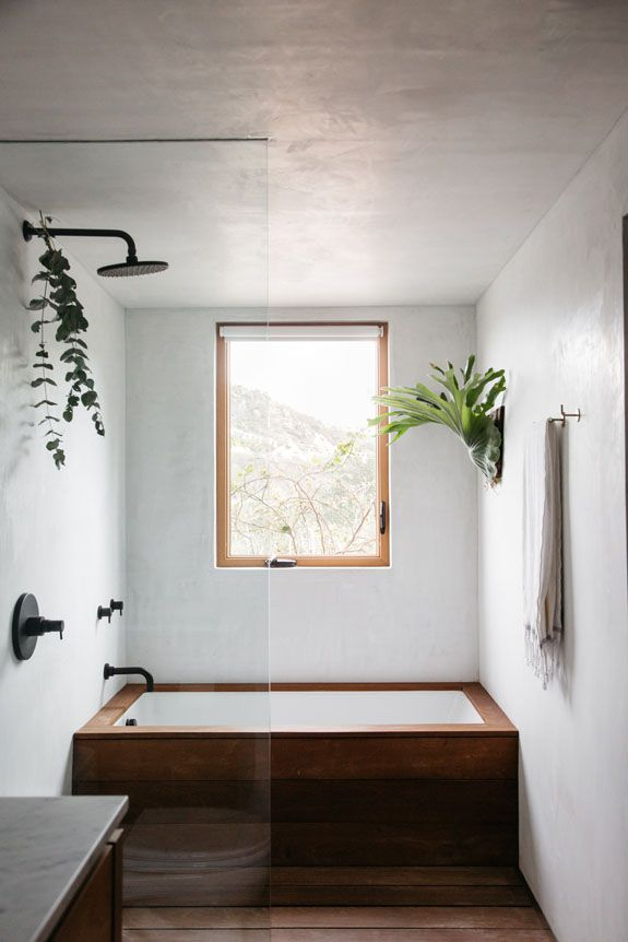 modern bathroom with wood bath tub. / sfgirlbybay