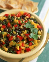 Corn Salsa    Ingredients:   2 cups frozen corn thawed or can corn      1/3 cup chopped purple onion      1/4 cup chopped red bell pepper      3 tablespoons chopped fresh cilantro      2 tablespoons fresh lime juice      1 to 2 tablespoons finely chopped jalapeno pepper      1/2 teaspoon salt    Preparation:  Combine all ingredients in a small bowl. Cover and refrigerate for 2 to 4 hours. Remove from refrigerator about 30 minutes before serving. Serve corn salsa with grilled meat or poultry.