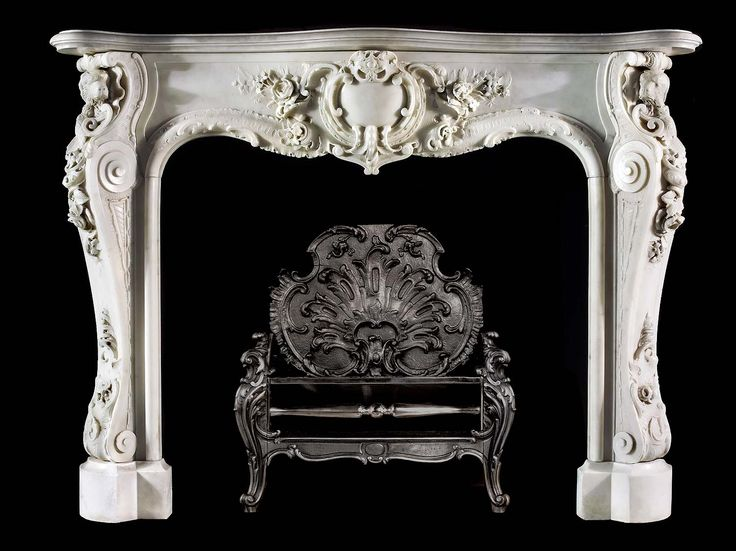 English Antique 18th Century Rococo Fireplace Mantel With Water Spaniel Heads.