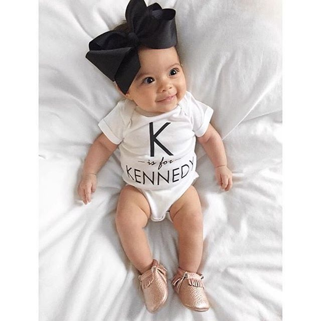 Sweet Kennedy looking adorable as always wearing our custom name onesie  You can find find this onesie in our shop, click the link in our bio. ❤️