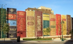 The Community Bookself is an intriguing piece of architecture at the Public Library in Kansas City, Missouri, resembling a book shelf. This striking façade, which runs along the south wall of the Central Library, features book spines measuring 25 feet by 9 feet, and showcases 22 titles reflecting a wide variety of reading interests suggested by readers.    Nice.