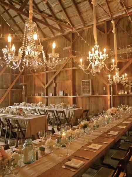 The Perfect Shabby Chic Rustic Barn Wedding Decor There Are Crystal Chandeliers With Drapey Beads Wall Cross Supports Used As Shelves To Display Vintage