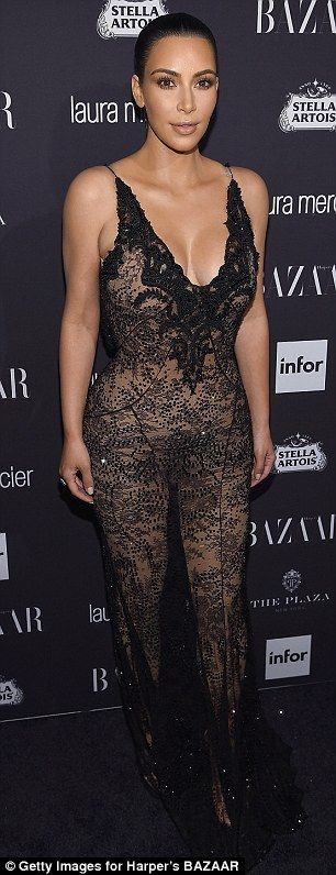 Clingy: The reality star's dress fit her figure like a glove and showed off her bountiful curves