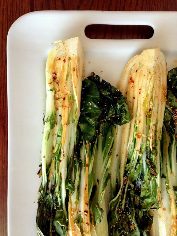 Spicy Roasted Bok Choy. Preheat oven to 400. Whisk together olive oil, sesame oil, soy sauce, garlic, red pepper flakes, & sesame seeds. Pour marinade over bok choy wedges. Roast for 6-7 minutes.