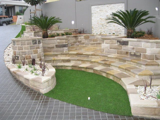 this uses stone cladding - is it a bit cheaper than sandstone?  i do like it, I like it with the pebbles as well. harboursidelandscaping.com.au