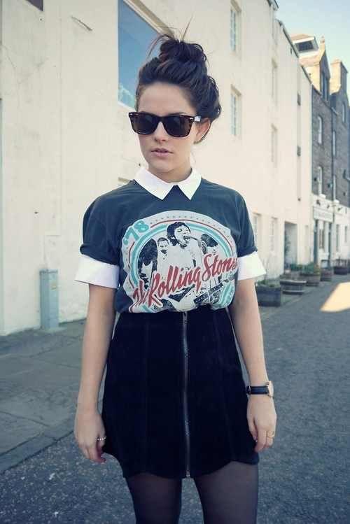 A rocker T-shirt tucked in a skirt