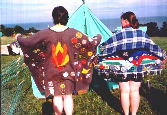 """This is the reverse of an earlier pin on this board.  Again yo can see the hand crafted """"campfire"""" on the back of this blanket.  The other leader has also attached several neckerchiefs to the blanket. Of course these are typically worn at night to stay warm during a campfire program (hence the name!)."""