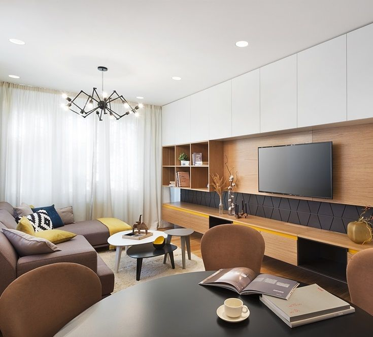 Wall décor in your apartment's small livingdoesn't have to mean artwork, you can use traditional shelving that will blend beautifully with the TV's background and creates more storage room while keeping the appeal of décor and design at it's finest!