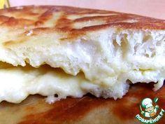 Выпечка с потрясающей начинкой - мечта, а не ужин! Пышное, воздушное тесто без дрожжей и вкусная сырная начинка - успех гарантирован!Пышный, румяный пирог так и просится в рот! Обратите внимание на …