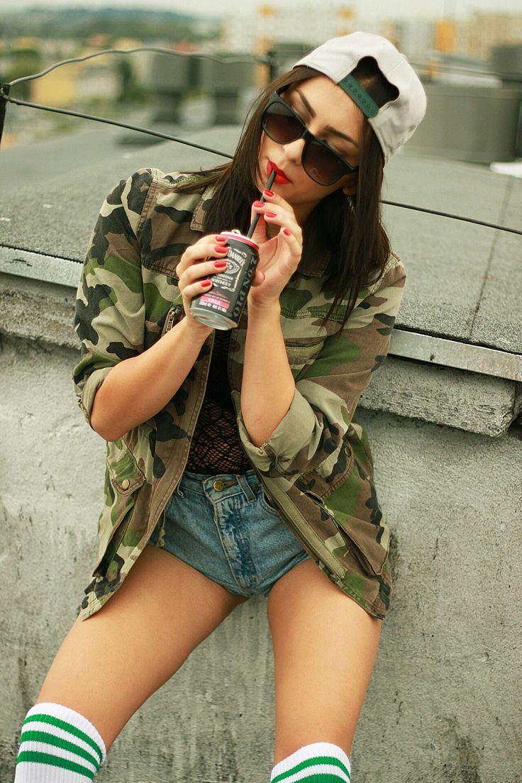 Love over the knee tube socks. Love the army jacket, the backwards hat, cute short shorts, sunglasses.. All ties together very well.