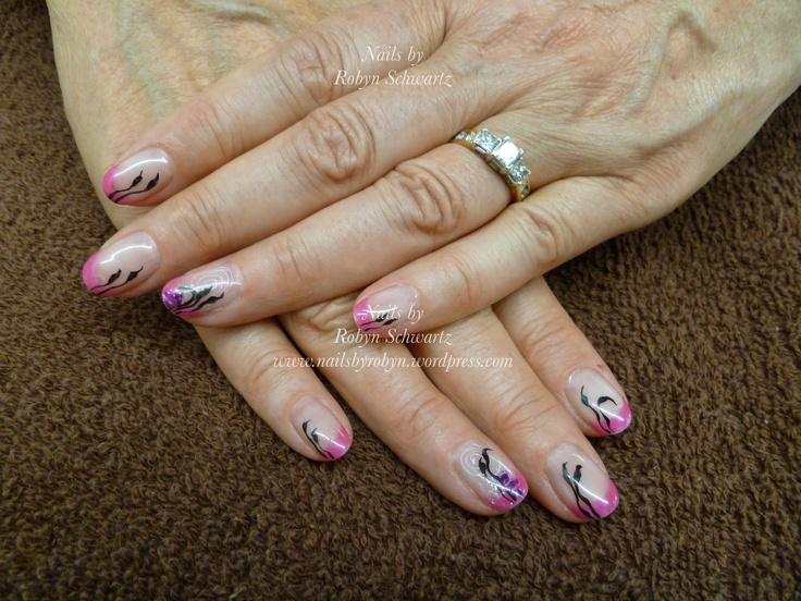 Gel nails, with a bit of bling and hand painted leaves and swirls.