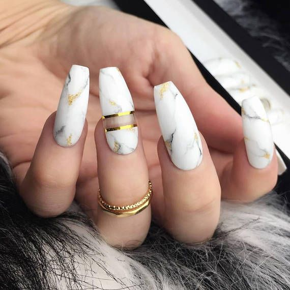 Glossy white press on nails with hand painted marble art, negative space and real gold flakes. Style pictured is Long Coffin in size S.  ✨FREE UK SHIPPING OVER £45 (code - 45FREE), FREE INTERNATIONAL SHIPPING OVER £55 (code - 55FREE)✨  Choose a standard 10 nail set or a Full Set of 20