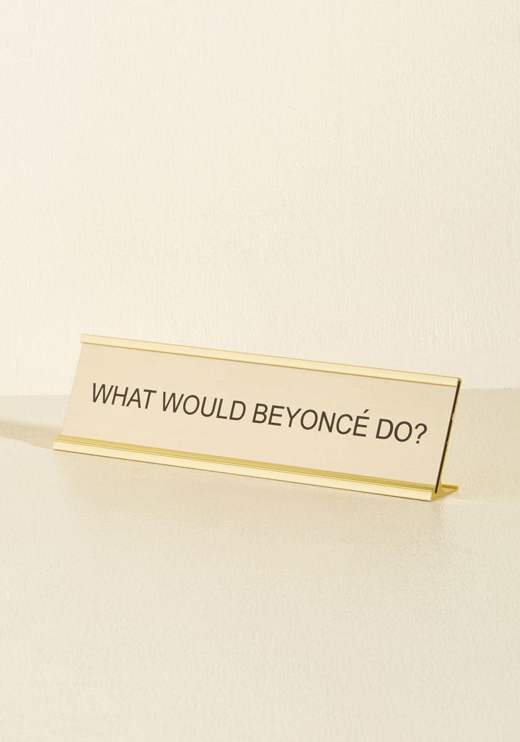 <p>Channel your inner Queen by placing this golden sign atop your work station! As your co-workers admire its shining plate, golden frame, and cheeky question to ponder, this desk plaque prompts everyone to pack just as much power into their day as the inspiring songstress does.</p>