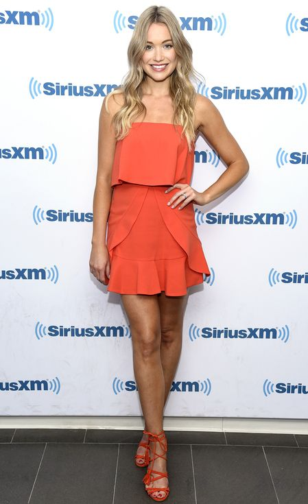 Katrina Bowden in an orange BCBG mini dress