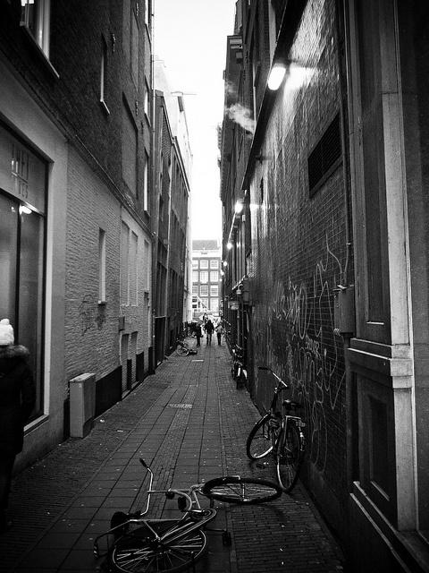 alley of drunken bicycles ~Tomasz Ćwiertnia photography