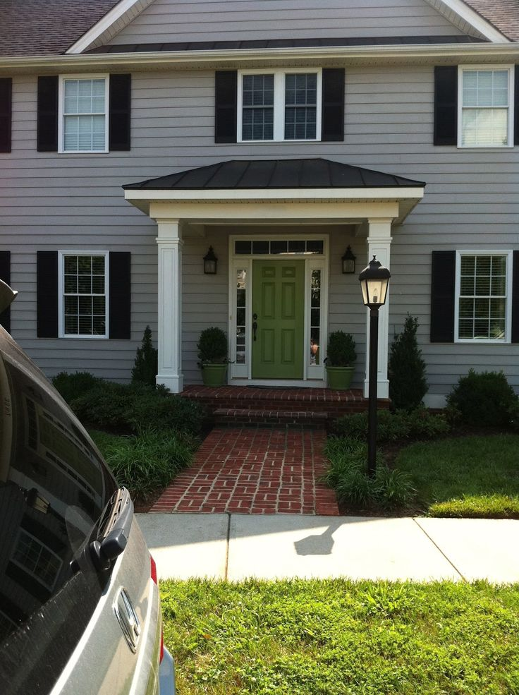 This is basically the colors of our house with the new shutters. I like the green front door - Google Search
