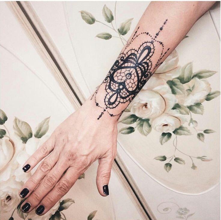 Lace wrist tattoo.  Heart lace tattoo
