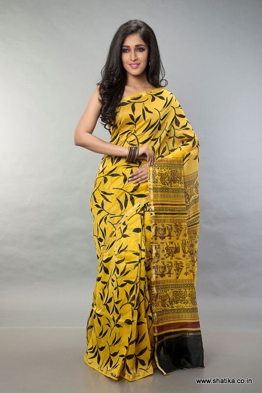 Dressed elegantly in yellow with frail leaves' bagh print in black, Tripti Yellow and Black Bagh Print Saree looks like shadowy leaves falling in autumn. With a flowy design all through the saree, the differently designed pallu instantly grabs attention.