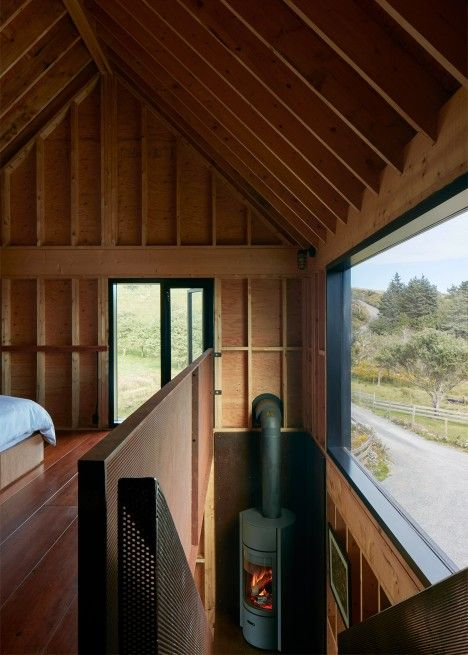 Weathering steel cabin in Canada features rustic and compact interior