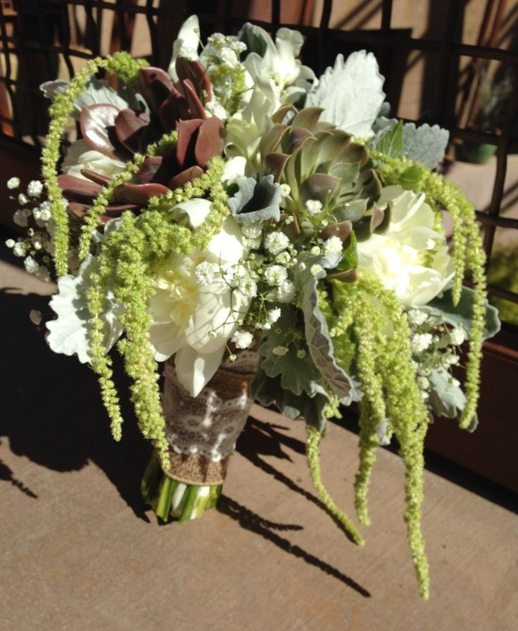 Enchanted Florist Las Vegas-whites and greens with succulents and hanging amaranthus.