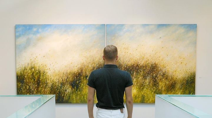 """The windswept grasses of Sheri Bakes impressive diptych, 'The Still Small Voice' perfectly capture the spirit of the West Coast summer. Her work is on display in Bau-Xi Vancouver's upper gallery on the Mezzanine. Artwork Details: Sheri Bakes, 'The Still Small Voice', oil on canvas 54"""" x 120"""""""