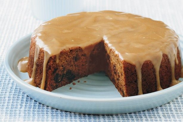 Indulge in a decadent fruit cake with rich caramel topping.