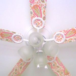Mod podge your ceiling fan with scrapbook paper!