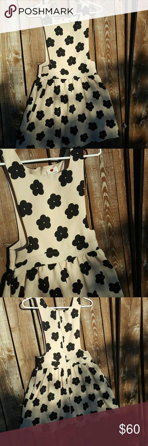 Cocktail dress Beautiful cream cocktail dress with cute black flowers. So pretty flared out and the zipper goes almost all the way down in the back. No stains in excellent condition! one clothing Dresses Mini