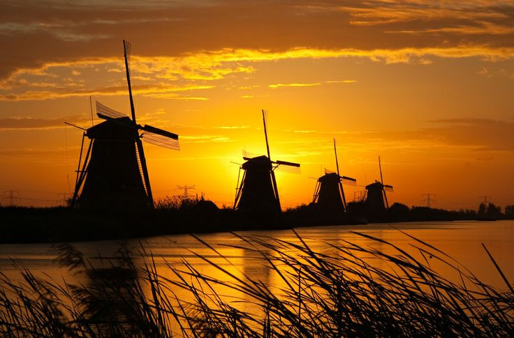 Sunrise Windmills  - The Kinderdijk Windmill Park in Holland features a large number of authentic windmills.