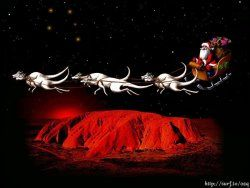 Santa with his six white boomers flying over Uluru, Central Australia.