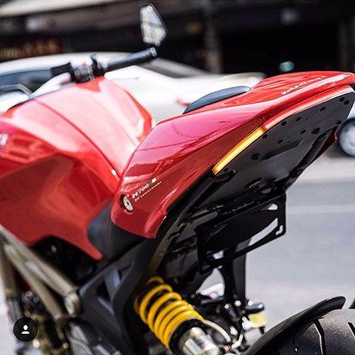 Ducati Monster 696 fender eliminator kit that includes rear LED turn signals and license plate bracket.